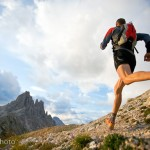 Klaus Fontana trail running in the Italian Dolomites under dark, cloudy skies